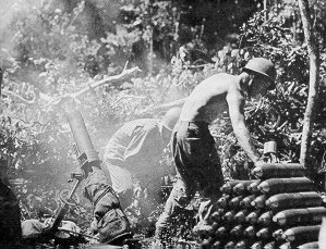 Gun crew firing 4.2-inch mortar in New Guinea during WWII