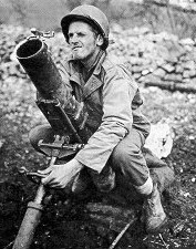 Gunner adjusting elevation of mortar, location unknown.